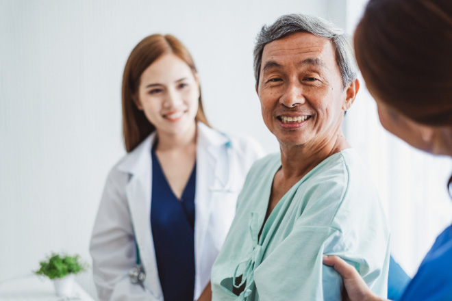 Man at Doctor's Office with nurse and doctor