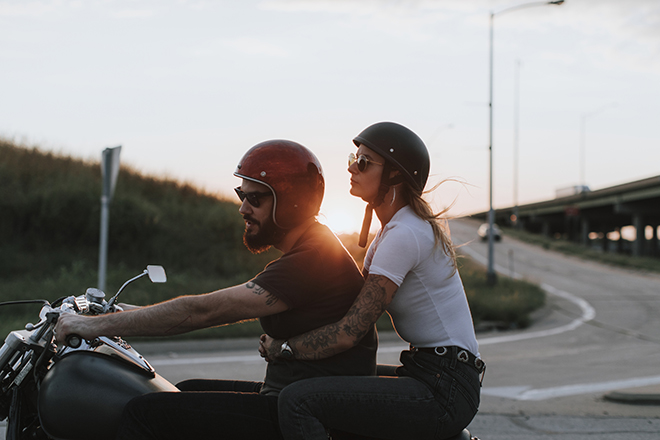 Motorcyclists at sunset man and woman